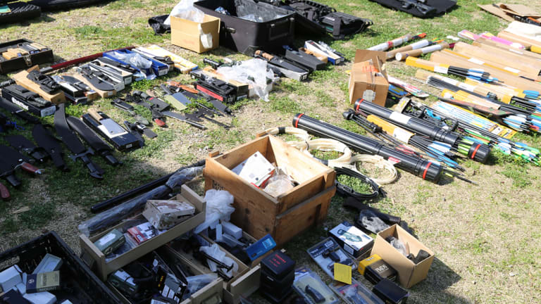 Police have found a massive arsenal of rifles, pistols, cross-bows, knives, swords and more than 2000 rounds of ammunition at a home in Richmond.