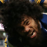 Isaiah Papali'i celebrates  after scoring a try in Canberra.