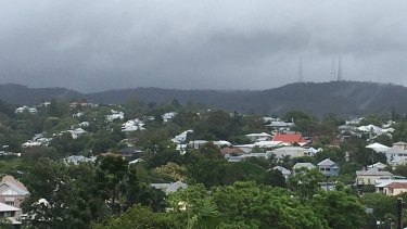 Rain clouds loom over Mt Coot-tha in Brisbane ahead of Sunday afternoon's expected dumping.