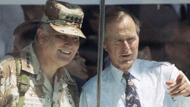General Norman Schwarzkopf and President George Bush watch the National Victory Parade in Washington, 1991.