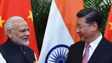 Indian Prime Minister Narendra Modi, left, shakes hands with Chinese President Xi Jinping in 2018.