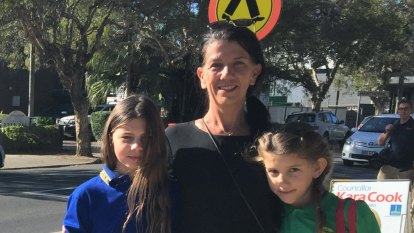 Residents rally after schoolgirls hit at pedestrian crossing