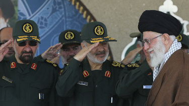 In this picture released by Iran, senior figures from the Revolutionary Guard salute Ayatollah Ali Khamenei.