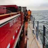 A Kernot-Grantville CFA tanker on board a barge heading to the bushfire at French Island.