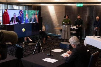 NZ Trade Minister Damien O'Connor and China's Commerce Minister, Wang Wentao, sign an upgraded free-trade deal via video-link on Tuesday.