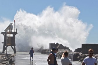 A monster wave in January 2015 that washed a woman off Nobbys breakwall in Newcastle.