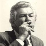 Bob Hawke smoking a cigar.