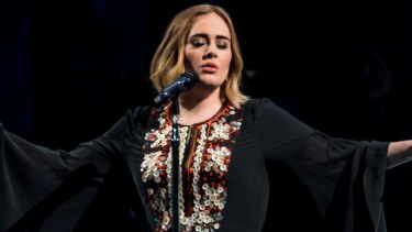 Listening to Adele at work could change your productivity, depending on your taste in music.
