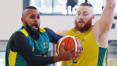 NBA stars Patty Mills and Aron Baynes in Boomers practice.