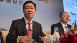 Evergrande chairman Hui Ka Yan,  The company has more than $US300 billion in liabilities, almost half of which are payables including to contractors.