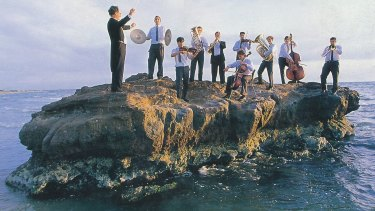 Rock music: Lewis Plumridge leads students from Mentone Grammar in a rehearsal for Jesus Christ Superstar on Seagull Rock, Mentone, in February 1998.