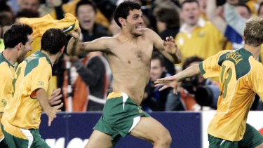 Australian players from left, Tony Vidmar, Scott Chipperfield, John Aloisi and Vincent Grella celebrate after defeating Uruguay on penalties during their second leg World Cup qualifier against Uruguay at Sydney's Olympic Stadium, Wednesday, Nov. 16, 2005 Australia booked a World Cup soccer finals berth for the first time since 1974. (AP Photo/Mark Baker)
