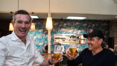 NSW Treasurer Dominic Perrottet having a beer with the owner Justin Small at The Balmain last week.