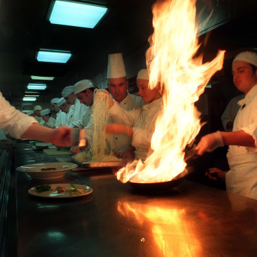 The Age caught apprentice chef George Calombaris learning how to flambe salmon at the Sofitel in 1997.