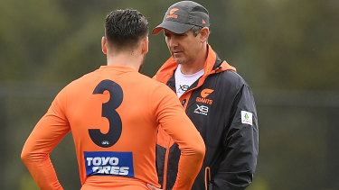 In talks: Giants coach Leon Cameron (right) will be hoping Stephen Coniglio signs a new contract.