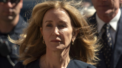 Felicity Huffman sentenced to 14 days in prison in US college scandal