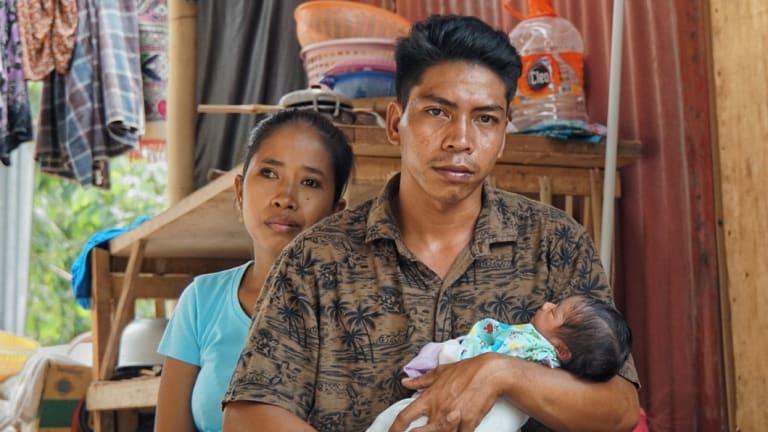 Hanan and his wife Reniatun with baby Akila, born since the earthquake.