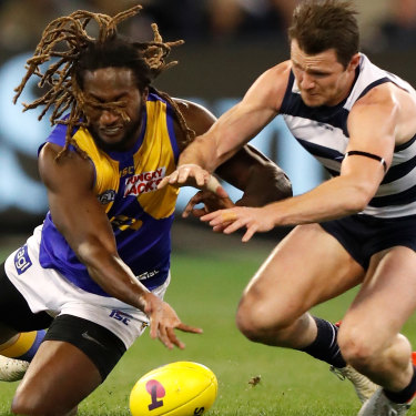 Nic Naitanui, left, shown here with Patrick Dangerfield, plays only 70 per cent of game time due to injury. Interchange reductions will force West Coast to rethink how they use their star ruckman.