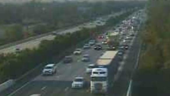 Traffic clears on M1 after car and motorbike crash causes delays