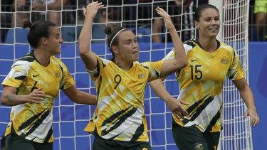 Bring it on: Caitlin Foord (centre) scores against Brazil.