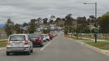 A lengthy traffic queue on Bettong Avenue in Throsby on Wednesday morning.