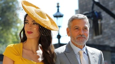 Amal Clooney and George Clooney are said to be in the running to be the two of the world's most high profile 'spiritual guides' to the latest royal baby.