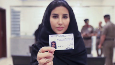 Esraa Albuti, an executive director at Ernst & Young in Saudi Arabia, displays her brand new driver's licence in June 2018.