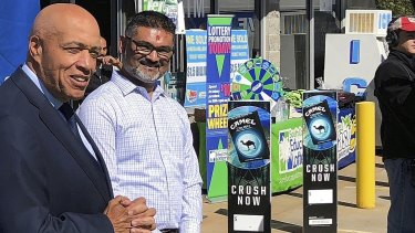 South Carolina Education Lottery chief operating officer Tony Cooper and KC Mart owner CJ Patel speak to the media after announcing the winning ticket was bought at the store.
