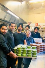 Chefs at Melbourne restaurant Horn Please with 100 serves of curry they made to donate through Alex Makes Meals to hungry health workers in Melbourne's big hospitals.