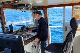 Garry Kerr at the wheel of his boat Eumeralla.
