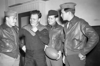 Three US airmen with squadron leader and Melbourne football club  champion Keith Truscott in 1942.
