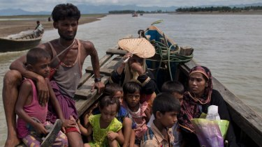 Newly arrived Rohingya Muslims from Myanmar travel in a boat to a camp for refugees in Shahparirdwip, Bangladesh, in 2017.