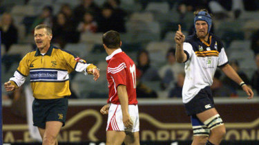 Wallabies second-rower Justin Harrison gestures to British and Irish Lions back Austin Healey during a match in 2001.