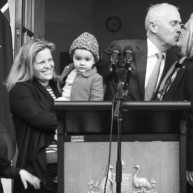 Malcolm Turnbull kisses his wife Lucy as daughter Daisy and grandchildren Jack and Alice stand by.