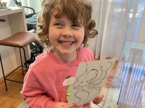 Little Vera Swartz with her big-name artwork by Luke Scibberas.
