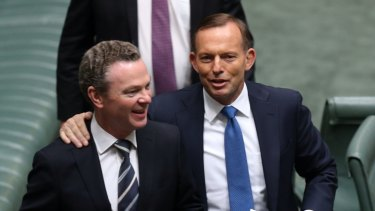 Winners are grinners: Christopher Pyne with Tony Abbott at the end of 2014.
