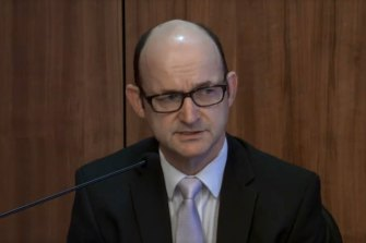 Victoria Police's head of legal services Fin McRae gives evidence on Thursday.