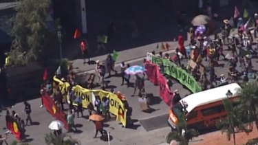 Extinction Rebellion launches its week-long protest in Brisbane marching through West End to the CBD.