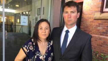 Parents Kim Macklin and Daniel Almond outside court at the inquest into their son's death.