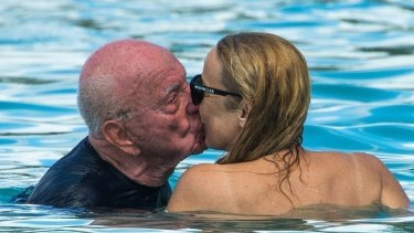 Kissing in the Caribbean: Rupert Murdoch and Jerry Hall lock lips in Barbados.