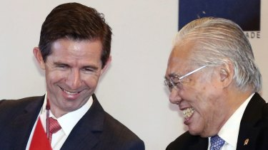 Australian Trade Minister Simon Birmingham, left, and Indonesian Trade Minister Enggartiasto Lukita at the  signing ceremony in Jakarta, Indonesia, on Monday.