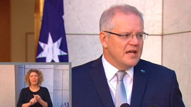 Paula Bun interpreting for Prime Minister Scott Morrison.