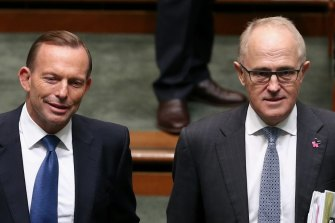 Tony Abbott and Malcolm Turnbull arrive for Question Time at Parliament House in 2015.