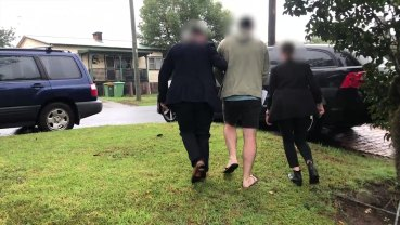 Justin Radford being taken into custody by AFP officers earlier this year.`