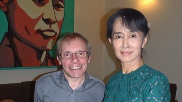 Sean Turnell, left, has long provided advice to Myanmar's elected leader Aung San Suu Kyi, right.