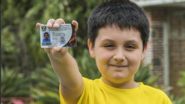 Carlos Santamaria Diaz shows his university identification card, in Cuernavaca, Mexico.