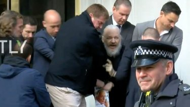 Julian Assange was arrested outside the Ecuadorian embassy in London on Thursday.