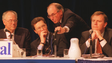 Confusion: Tony Staley (far left) with then Liberal leader Alexander Downer, John Howard with his hand over the microphone and Peter Costello at the 1994 Liberal conference in Albury.