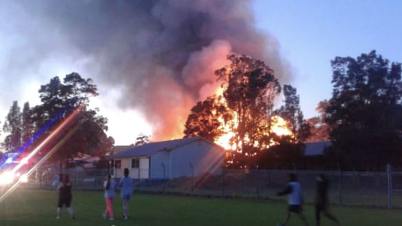 Wollongong school building engulfed by suspicious fire