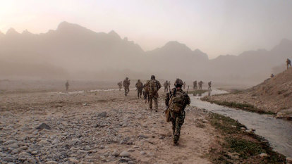 Two worlds collide as defamation lawyers quiz Afghan farmer